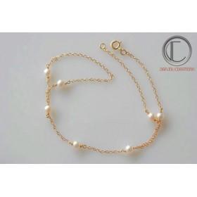 Bracelet main  perle fine.Or750/100